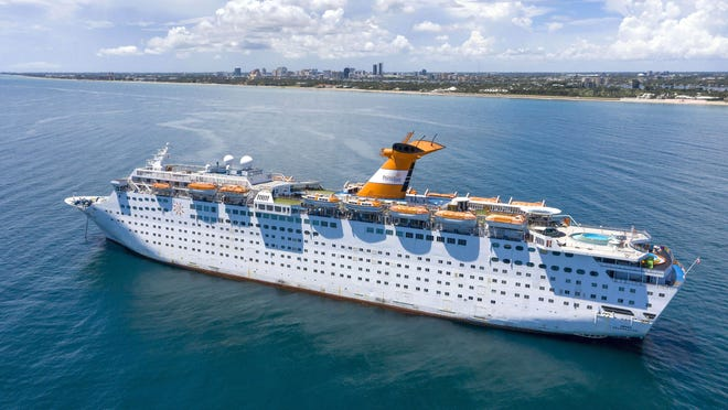 The Grand Celebration cruise ship is anchored off the coast of Palm Beach, in this August 5, 2020 photo.