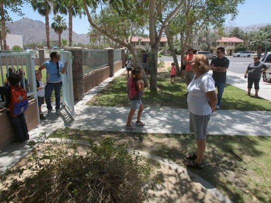 Parents wait outside Benjamin Franklin Elementary to pickup their kindergarteners on Wednesday in La Quinta.