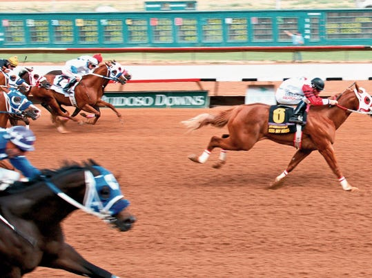 The Ruidoso Down racing season begins with Ruidoso Futurity trials Friday. Pictured is Kiss My Hocks, winner of the 2014 Ruidoso Futurity.
