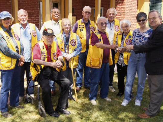 The Lions Club of Silver City presented a check for 20,000 to the Silver City Museum on Friday. Present were, from left, Cissy McAndrew, Lewis Springer, Leonard Pritikin, Jerimiah Garcia, Bob Prewit, Erin Boulton-Shepard, Ansel Walters, Betty Conner   Bob Corwin, Museum Director Tracy Spikes and Phyllis McQuaide, president of the Silver City Museum Society. Randal Seyler   Sun-News