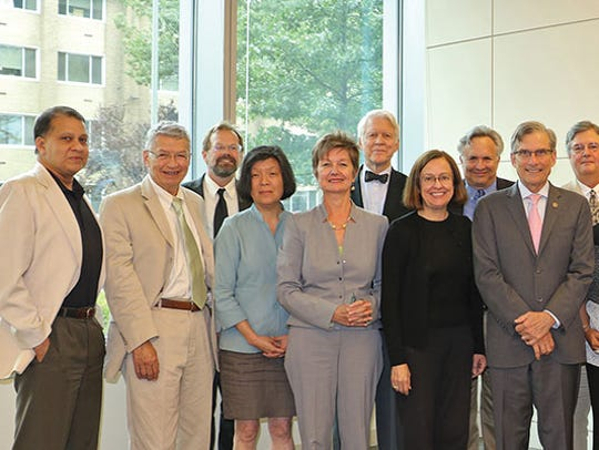 Members of the National Council on the Humanities are shown in July of 2015. Christopher Merrill, in a black tie, can be seen in the back row. Photo from the National Endowment for the Humanities.