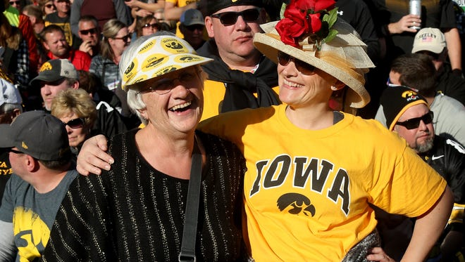 A pair of Iowa fans in the stands during the 102nd Rose Bowl Game between the Stanford Cardinal and the Iowa Hawkeyes on January 1, 2016 at the Rose Bowl in Pasadena, California.