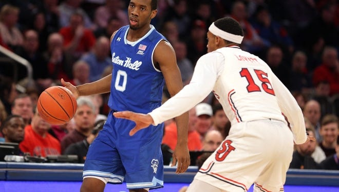 Seton Hall Pirates guard Khadeen Carrington (0) controls the ball against St. John's Red Storm guard Marcus LoVett (15) during the first half at Madison Square Garden. Mandatory Credit: Brad Penner-USA TODAY Sports