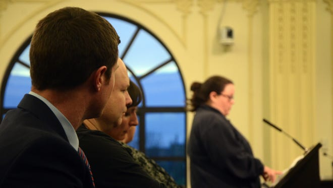 Attendees listen to resident Kristin Blood speak in favor of the proposed urban livestock ordinance during the Battle Creek City Commission meeting Tuesday.