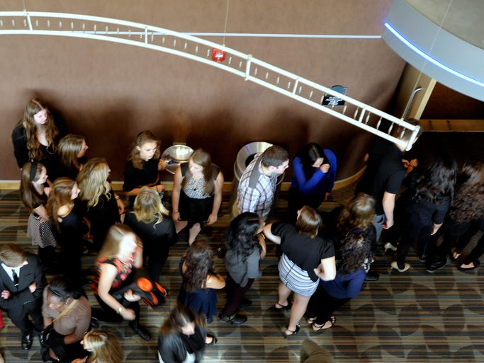 Students line up as they enter the theater as Macomb