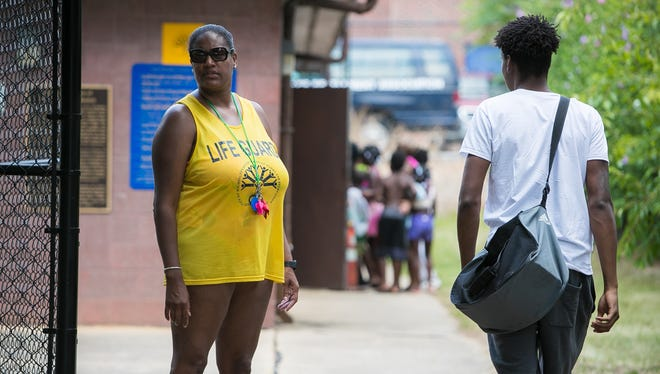 """""""There was no discrimination or prejudice,"""" says Glenda Pinkett, pool manager at Dr. Foster M. Brown Pool in Wilmington as she stands by the entrance gate as another lifeguard arrives for duty."""