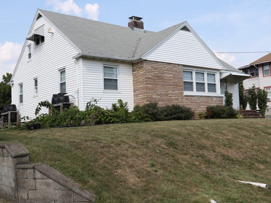 A home on Henderson Street in the City of Poughkeepsie on Tuesday. Despite utilizing rain barrels on his down spouts, the homeowner has had a hard time maintaining his landscaping through the high heat and low rainfall this summer.