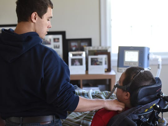 Caregiver Colin Granroth helps Ben Jones deal with
