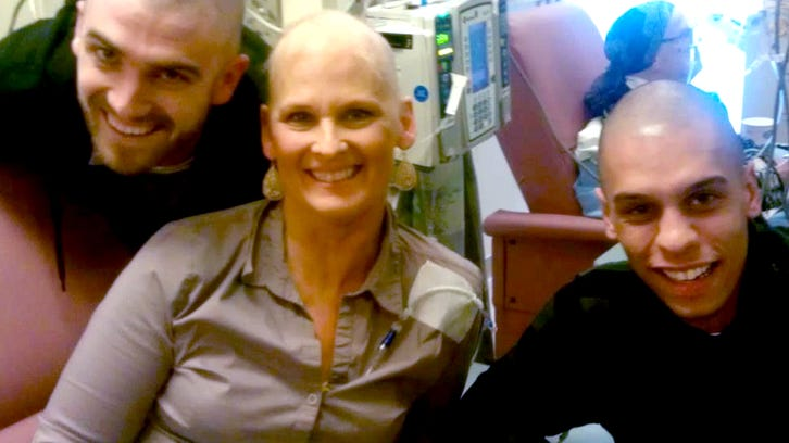 Julie Elmore's last chemo. Sons Mike and Tony Elmore surprised her by shaving their heads.