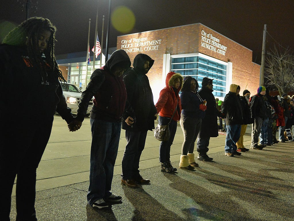 Protesters demonstrate outside the Ferguson Police Department on March 4 after the Department of Justice decided today not to charge former Ferguson police officer Darren Wilson in the 2014 shooting of Michael Brown in Ferguson, Mo.