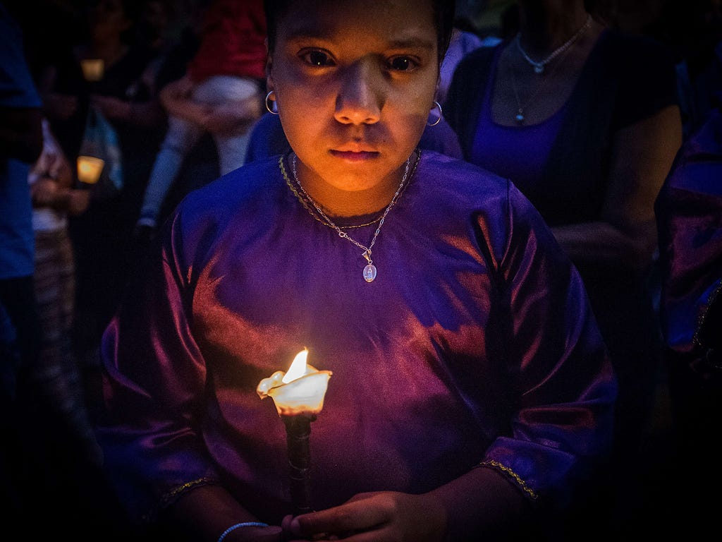 A woman participates in the procession of the Nazarene of Saint Paul Christ's Day during Holy Week on April 1 outside the Santa Teresa church in Caracas, Venezuela.