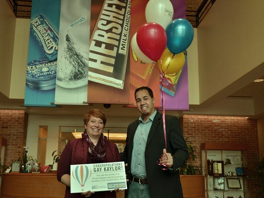Gay Kaylor, left, of The Hershey Company, receives her United Way prize, a hot air balloon ride for six people, from United Way CEO Kenny Montijo.