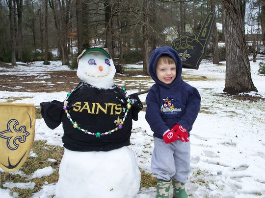 Jackson Scott Lucas, 3, celebrates his first big snow and the Saints' first Super Bowl in February 2010.