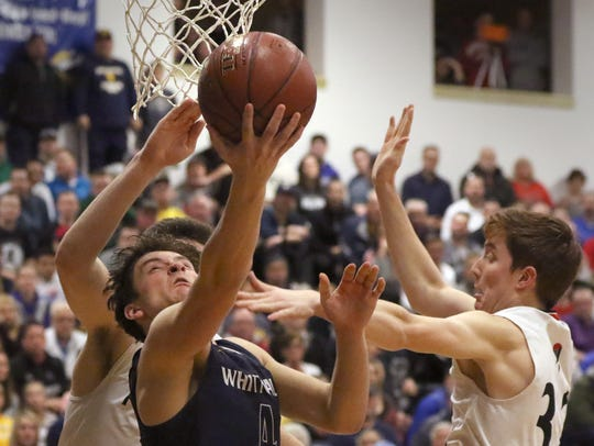 Whitnall's Joey Tilley fires for two points from beneath