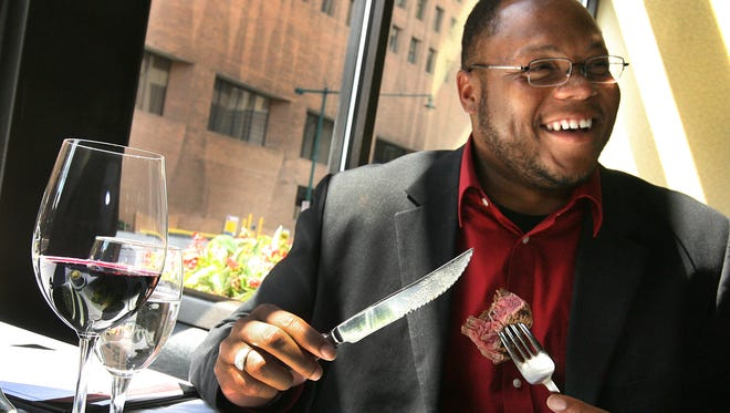Roderick Wheeler digs into a filet at Ruth's Chris Steak House, 45 South Illinois St. A broiled 6-ounce filet or 10-ounce rib-eye is on the restaurant's $39 three-course Devour Indy menu.