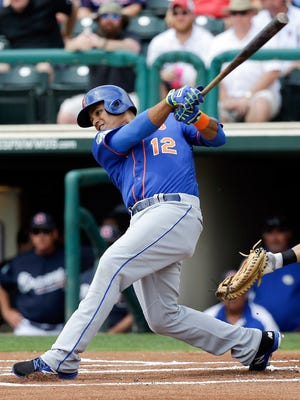 Juan Lagares taking a swing Saturday.