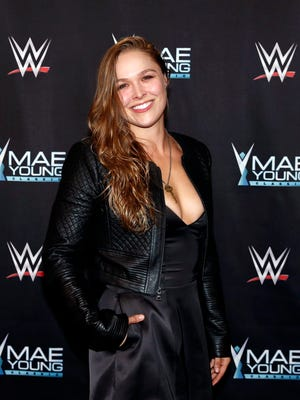 Ronda Rousey celebrates the Mae Young Classic at the Thomas & Mack Center.