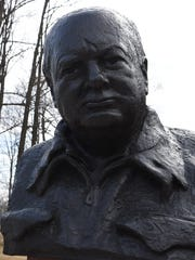 A bust of Winston Churchill behind the FDR Presidential Library and Museum.