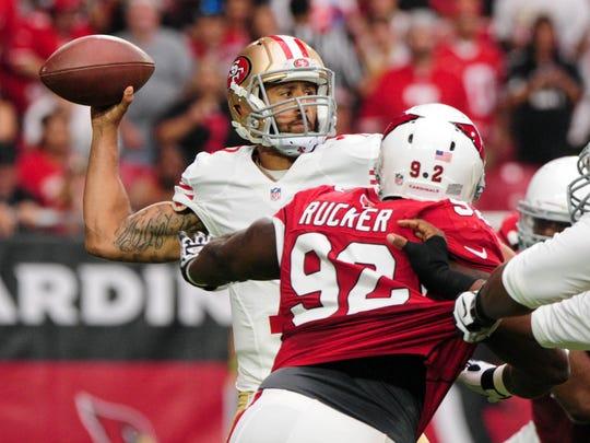 San Francisco 49ers quarterback Colin Kaepernick (7) throws an interception to Arizona Cardinals cornerback Justin Bethel (28) during the first half at University of Phoenix Stadium.