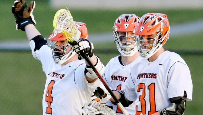 Central York's T.J. Ross, left, and Connor Hoch, right, celebrate a goal during lacrosse action against York Catholic earlier this season. The Panthers currently hold down the top spot in the Y-A League with a 7-0 record. Dawn J. Sagert photo