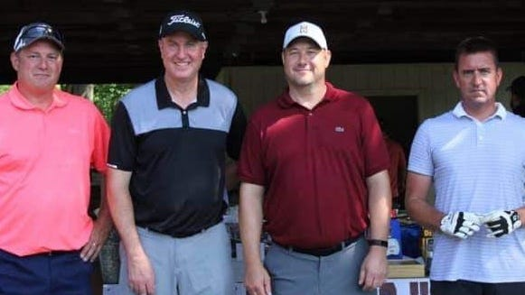 The team of Ryan Oprandi, Mark Herchek, Jason Beach, and Bobby Menegay tied for first place at the Waterloo Athletics Boosters golf outing last weekend.