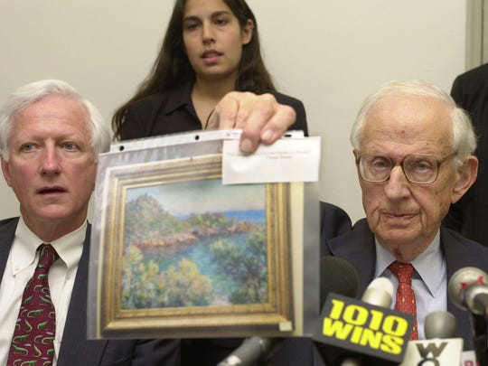 Manhattan District Attorney Robert Morgenthau, right, holds a photo of a painting by Monet from the collection of Tyco Interenational CEO Dennis Kozlowski, as Assistant District Attorney Harold Wilson, left, looks on, during a news conference in New York, Tuesday, June, 4, 2002.  Morgenthau has indicted Kozlowski on charges of avoiding more than $1 million in sales tax on paintings he purchased.  (AP Photo/Suzanne Plunkett)