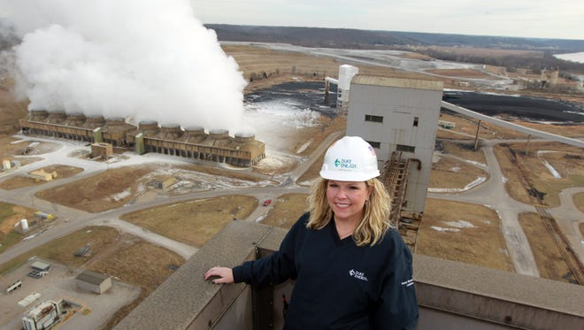 Duke Energy wants an electric rate increase in Northern Kentucky for projects including a multimillion-dollar spending plan at East Bend Station in Boone County. The plant is shown in this 2014 file photo with former plant general manager Jenny Bulach on the roof.