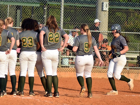 Gallatin's Sidney Link (2) makes her way to home plate