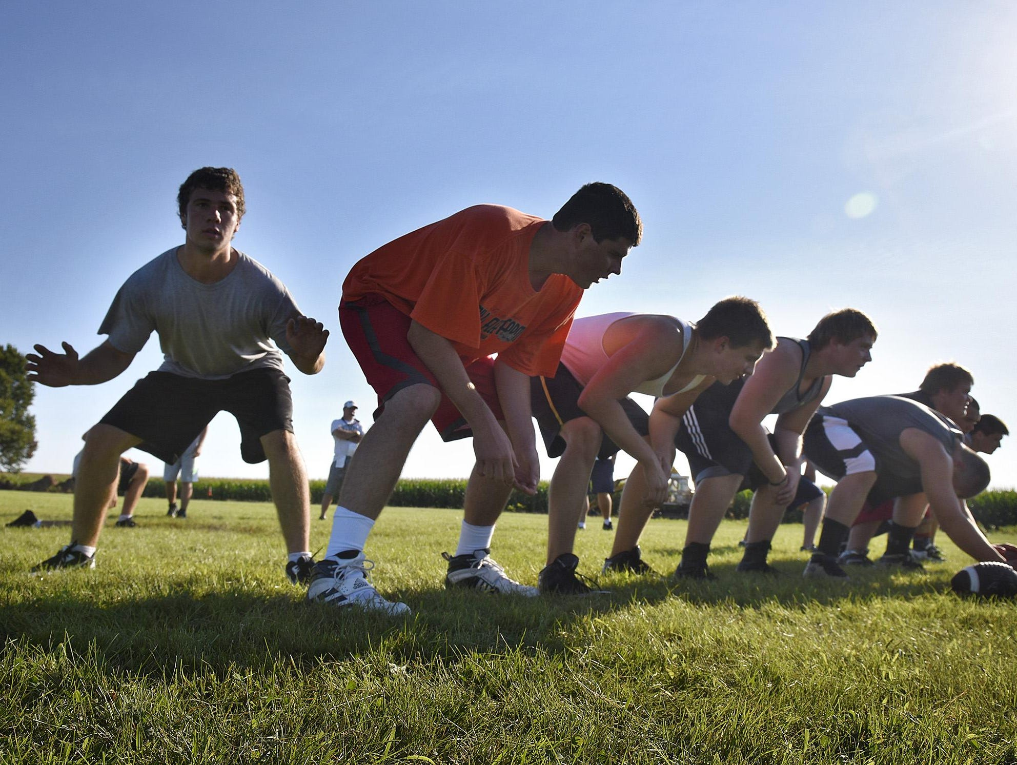 Holdingford players practice an extra point during practice Wednesday in Holdingford.