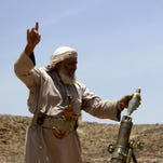 An Armed Yemeni fighter, loyal to Yemen's Saudi-backed President Abedrabbo Mansour Hadi, fires a mortar shell during clashes with Shiite Houthi rebels in the area of Jaadan, in Marib province east of the capital Sanaa on May 15, 2015.