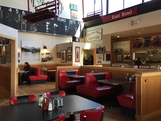 The interior of Red Hut Cafe pays homage to Tahoe sports (see lift chairs at top) and old-school Reno baseball.