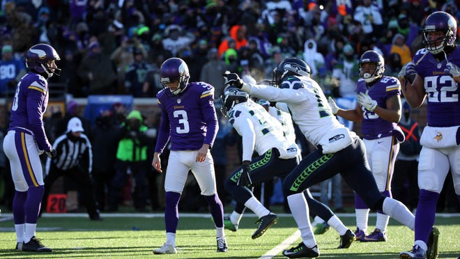 Minnesota Vikings kicker Blair Walsh (3) reacts after missing a field goal attempt against the Seattle Seahawks in the fourth quarter of a NFC Wild Card playoff football game at TCF Bank Stadium.
