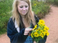 Gabrielle Campo plucks the petals off her yellow bouquet.