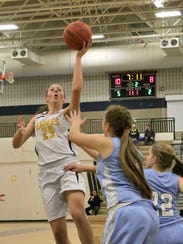 Lexey Tobel goes strong to the hoop in the first half