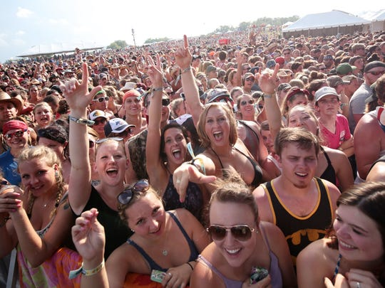 Fans dance as Tracy Lawrence performs during the Faster Horses Festival on Friday, July 17, 2015, at  Michigan International Speedway in Brooklyn.