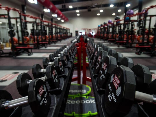 Racks of dumbbells are located in the center of the new weight room in the UL Athletics Performance Center Thursday, Sept. 10, 2015.