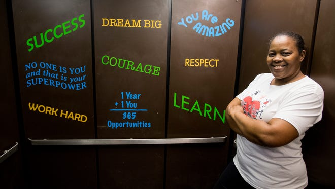 Earnestine Woods, shown in a recently repainted elevator at Brewbaker Middle School, as she and her organization Have a Heart 4 Children, work on their annual spring break project on Friday March 9, 2018.This year the project is at the Brewbaker Middle School campus in Montgomery, Ala.