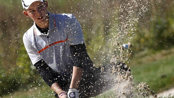 Ashland High's Tyler Sabo hits out of a bunker during the OHSAA Division I boys state golf tournament on Friday, Oct. 18, 2019 on the Scarlet Course at The Ohio State University Golf Club.