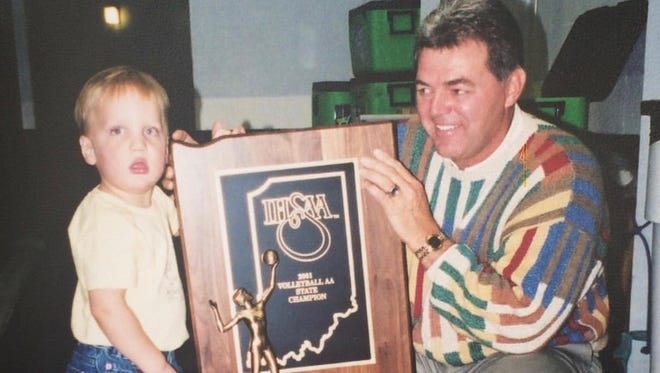 Caleb Middlesworth with his grandfather, Reece Peacock, in 2001. Burris won 18 state volleyball titles during Peacock's 20 years as an assistant.