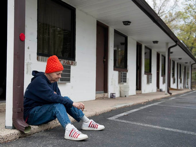 Dorothy Shank sits outside her room at the El Sombrero Motel in Pemberton; Shank is one of many homeless that are staying at the motel and several others in the area through the help of the Christian Caring Center in Pemberton, on Friday, May 9, 2014.