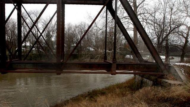 The body of Gene Burton was found at the base of a railroad trestle in January 1997. The trestle is located next to the Cardinal Greenway walking trail bridge near McCullough Boulevard.