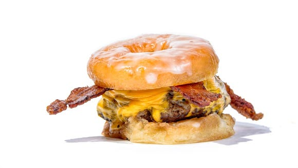 Enjoy a glazed doughnut burger from Sickies Garage