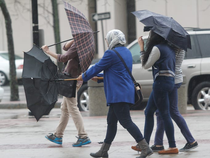 Pedestrians in White Plains, battled the elements to get to their destinations on April 15, 2014.  Some of their umbrellas didn't fair so well.