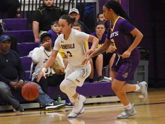 LSUA guard Brittany Hall (3) drives to the lane against