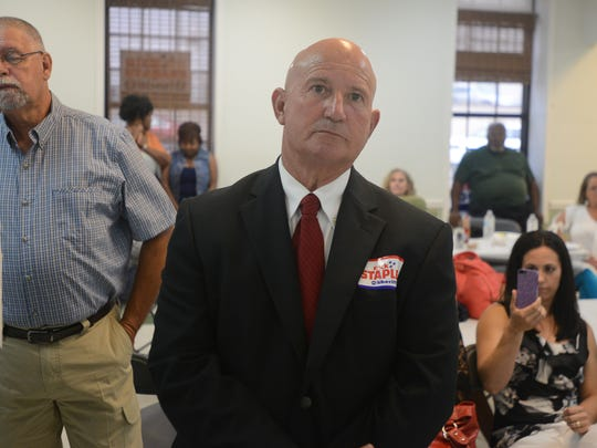 Madison County Sheriff candidate Rick Staples watches as early voting numbers are read Thursday evening.