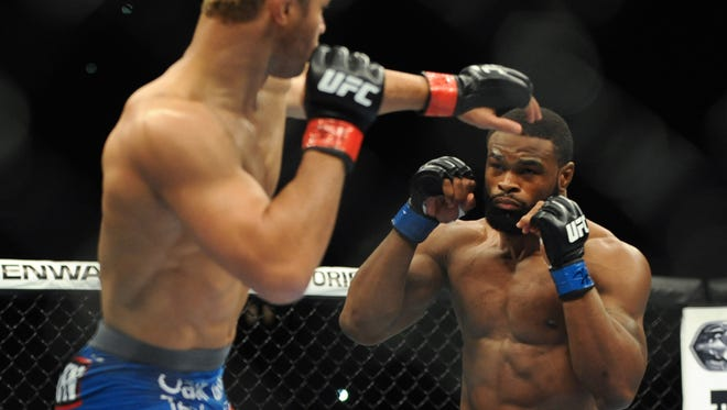 Tyron Woodley, right, fights and defeats Josh Koscheck at UFC 167 in November.