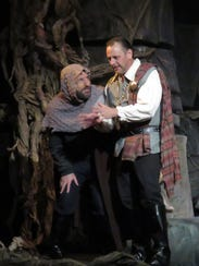 Macbeth, played by Ron Feltner, plots with his assassin,