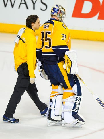 Pekka Rinne is assisted off the ice on Jan. 13.