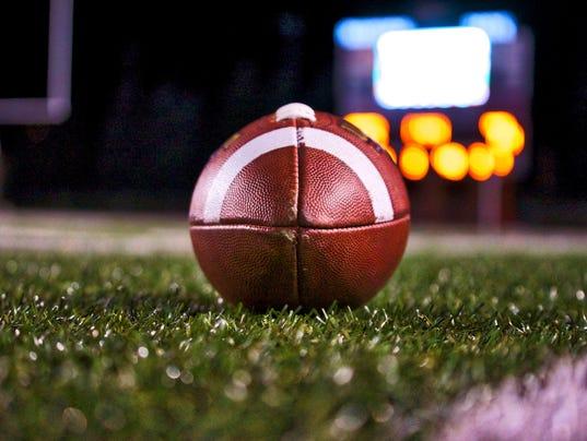 istock football on grass 2