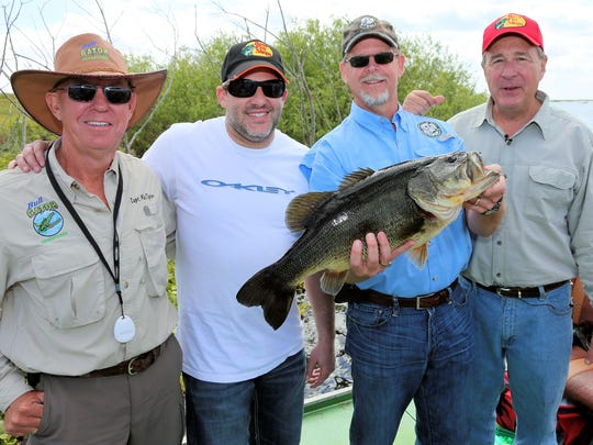 Fishing legend Johnny Morris, far right, poses with friends including racing star Tony Stewart.